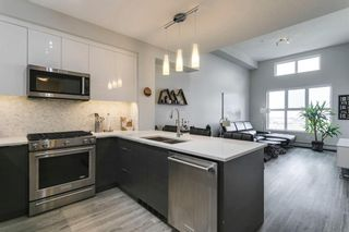 Photo 5: 1406 95 Burma Star Road SW in Calgary: Currie Barracks Apartment for sale : MLS®# A1134352