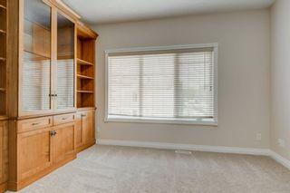 Photo 13: 4111 Garrison Boulevard SW in Calgary: Garrison Woods Row/Townhouse for sale : MLS®# A1108505