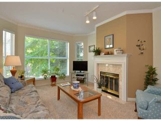 """Photo 1: 217 7161 121ST Street in Surrey: West Newton Condo for sale in """"The Highlands"""" : MLS®# F1418736"""