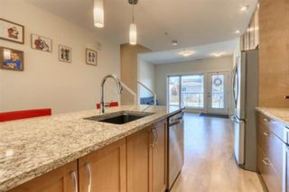 Photo 14: 206 20 Brentwood Common NW in Calgary: Brentwood Row/Townhouse for sale : MLS®# A1094821