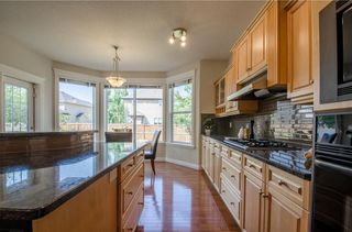 Photo 19: 152 STRATHLEA Place SW in Calgary: Strathcona Park House for sale : MLS®# C4130863