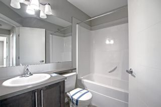 Photo 18: 555 Redstone View NE in Calgary: Redstone Row/Townhouse for sale : MLS®# A1149779