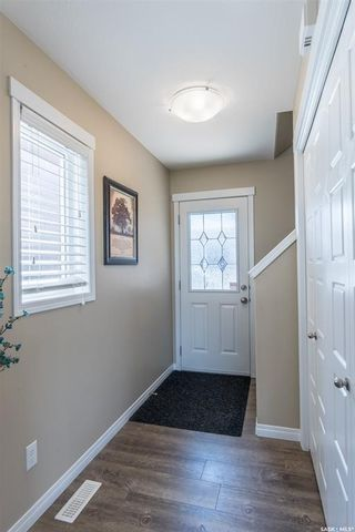 Photo 2: 235 Henick Crescent in Saskatoon: Hampton Village Residential for sale : MLS®# SK840372