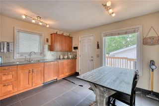 Photo 9: 6 WEST AARSBY Road: Cochrane Semi Detached for sale : MLS®# C4302909
