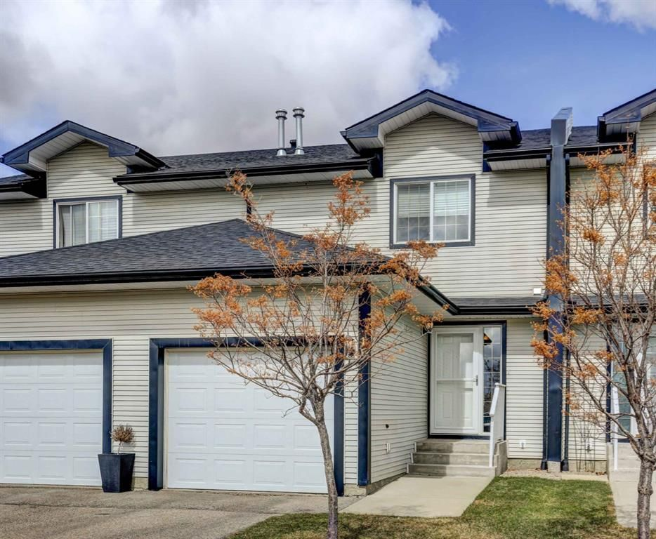 Main Photo: 15 12 Silver Creek Boulevard NW: Airdrie Row/Townhouse for sale : MLS®# A1090078
