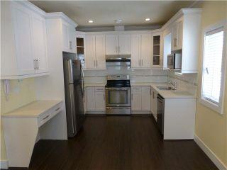 Photo 2: 2053 E 1ST Avenue in Vancouver: Grandview VE 1/2 Duplex for sale (Vancouver East)  : MLS®# V1078049