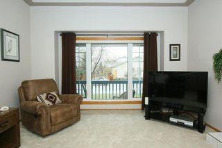 Photo 7: 185 WEST MCDOUGAL Road: Cochrane House for sale : MLS®# C4184033