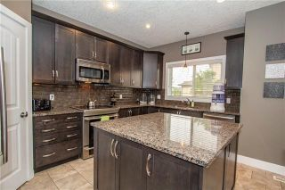 Photo 2: 702 CANOE Avenue SW: Airdrie Detached for sale : MLS®# C4287194