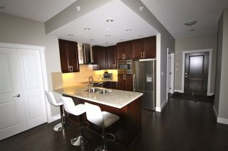 "Photo 4: 806 1415 PARKWAY Boulevard in Coquitlam: Westwood Plateau Condo for sale in ""Casade"" : MLS®# R2010040"