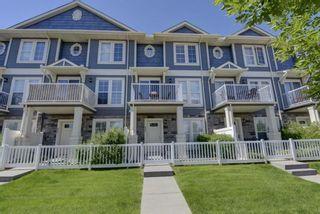 Photo 1: 653 Auburn Bay Boulevard SE in Calgary: Auburn Bay Row/Townhouse for sale : MLS®# A1147022