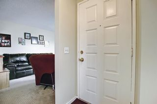 Photo 3: 1 75 TEMPLEMONT Way NE in Calgary: Temple Row/Townhouse for sale : MLS®# A1138832