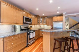 Photo 1: 5893 MAYVIEW Circle in Burnaby: Burnaby Lake Townhouse for sale (Burnaby South)  : MLS®# R2468294