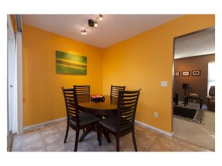 """Photo 3: 101 3000 RIVERBEND Drive in Coquitlam: Coquitlam East House for sale in """"RIVERBEND"""" : MLS®# V859605"""