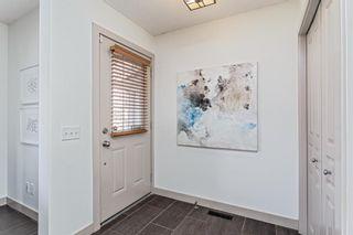 Photo 5: 27 Auburn Bay Manor SE in Calgary: Auburn Bay Detached for sale : MLS®# A1073937