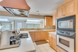 """Photo 11: 8217 WOODLAKE Court in Burnaby: Government Road House for sale in """"GOVERNMENT ROAD AREA"""" (Burnaby North)  : MLS®# R2159294"""
