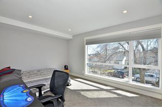 Photo 19: 154 21 Avenue NW in Calgary: Tuxedo Park Row/Townhouse for sale : MLS®# A1098746