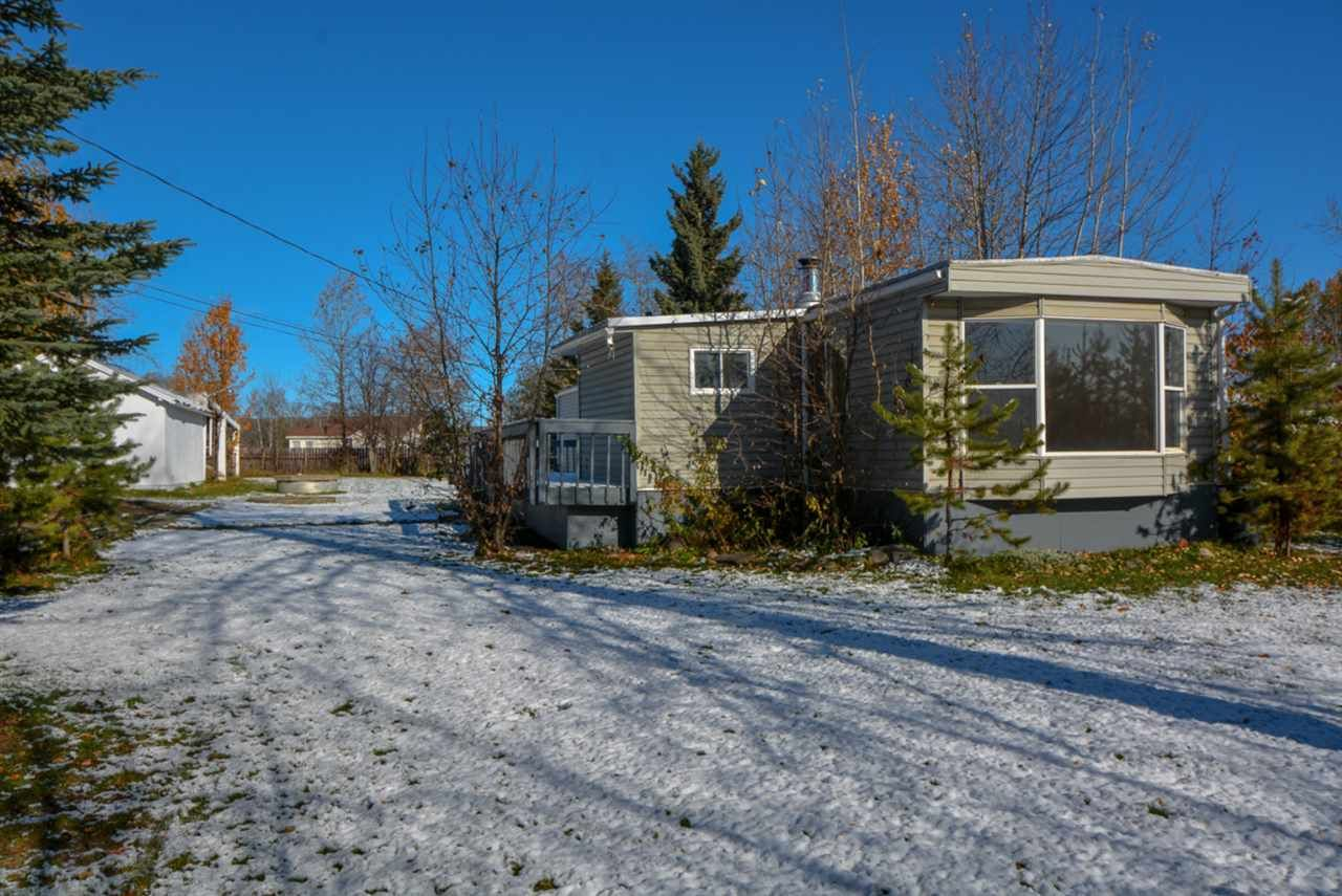 "Main Photo: 10928 POPLAR Avenue in Fort St. John: Fort St. John - Rural W 100th Manufactured Home for sale in ""CLAIRMONT SUBDIVISION"" (Fort St. John (Zone 60))  : MLS®# R2412337"