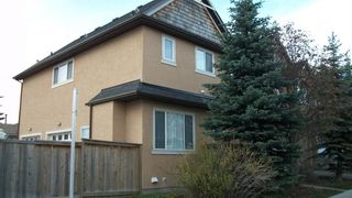 Photo 3: 147 23 Avenue NW in Calgary: Tuxedo Park Row/Townhouse for sale : MLS®# A1047875