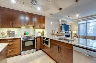 Photo 7: 731 2 Avenue SW in Calgary: Eau Claire Row/Townhouse for sale : MLS®# A1124261