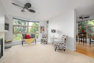"""Photo 2: 404 9339 UNIVERSITY Crescent in Burnaby: Simon Fraser Univer. Condo for sale in """"HARMONY AT THE HIGHLANDS"""" (Burnaby North)  : MLS®# R2578073"""