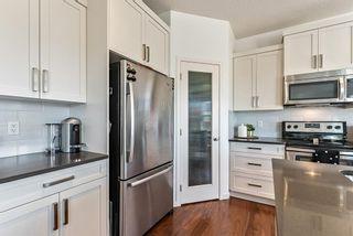 Photo 11: 28 Auburn Glen View SE in Calgary: Auburn Bay Detached for sale : MLS®# A1095232
