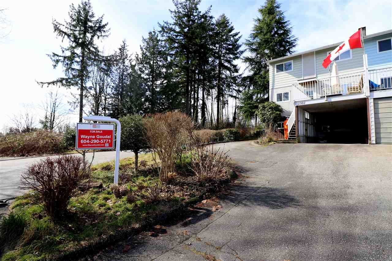 Main Photo: 1301 VIVIAN Place in Port Coquitlam: Mary Hill Condo for sale : MLS®# R2548607