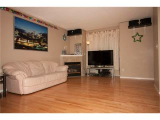 Photo 4: 1001 111 TARAWOOD Lane NE in Calgary: Taradale House for sale : MLS®# C4059766