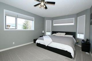 Photo 24: 306 WEST TERRACE Place: Cochrane House for sale : MLS®# C4117766