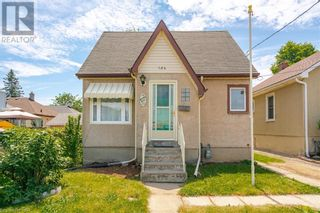 Photo 2: 154 CARLTON Street in St. Catharines: House for sale : MLS®# 40116173