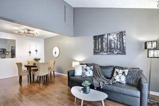Photo 2: 1701 2520 Palliser Drive SW in Calgary: Oakridge Row/Townhouse for sale : MLS®# A1099510
