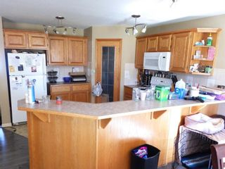 Photo 2: 907 WESTMOUNT Drive: Strathmore Semi Detached for sale : MLS®# A1119443