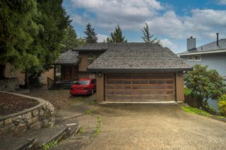 Photo 1: 1305 CHARTER HILL DRIVE in Coquitlam: Upper Eagle Ridge House for sale : MLS®# R2616938