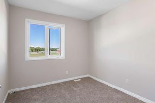 Photo 29: 407 620 Luxstone Landing SW: Airdrie Row/Townhouse for sale : MLS®# A1121530
