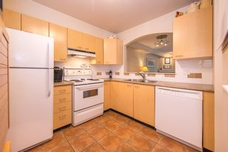 """Photo 11: 206 8495 JELLICOE Street in Vancouver: Fraserview VE Condo for sale in """"RIVERGATE"""" (Vancouver East)  : MLS®# R2072919"""