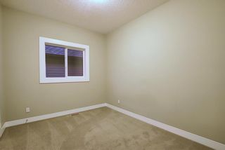 Photo 32: 1100 Brightoncrest Green SE in Calgary: New Brighton Detached for sale : MLS®# A1060195