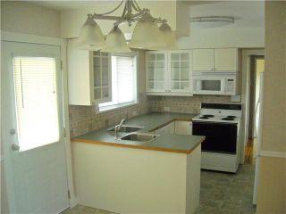 Photo 5: 6744 BURNS Street in Burnaby: Upper Deer Lake House for sale (Burnaby South)  : MLS®# V844970