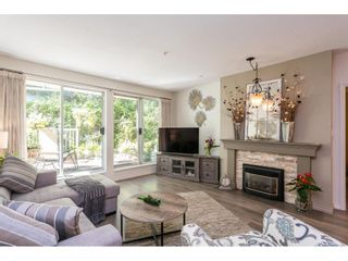 """Photo 4: 102 2733 ATLIN Place in Coquitlam: Coquitlam East Condo for sale in """"ATLIN COURT"""" : MLS®# R2475795"""