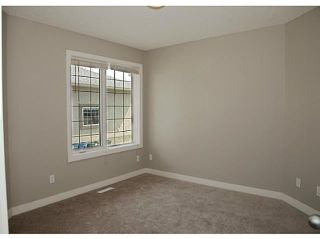 Photo 12: 130 RIVERSIDE Crescent NW: High River Residential Attached for sale : MLS®# C3612435