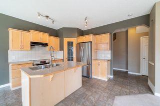 Photo 7: 130 New Brighton Close SE in Calgary: New Brighton Detached for sale : MLS®# A1086950