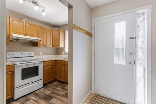 Photo 5: 84 2511 38 Street NE in Calgary: Rundle Row/Townhouse for sale : MLS®# A1115579