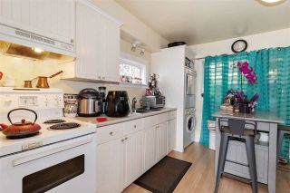 Photo 2: 940 IOCO Road in Port Moody: Barber Street House for sale : MLS®# R2620078