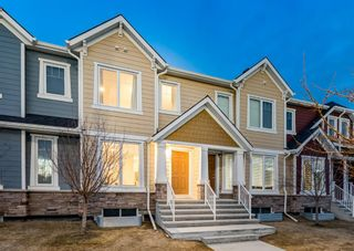 Photo 1: 102 2400 RAVENSWOOD View SE: Airdrie Row/Townhouse for sale : MLS®# A1092501