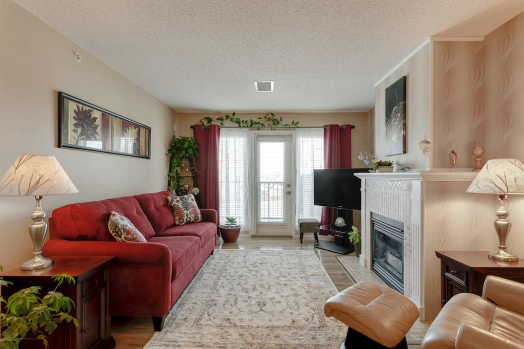 Main Photo: 406 300 Edwards Way NW: Airdrie Apartment for sale : MLS®# A1071313