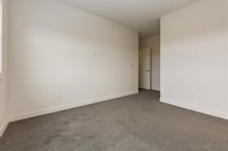 Photo 10: 208 45 Aspenmont Heights SW in Calgary: Aspen Woods Apartment for sale : MLS®# A1075895