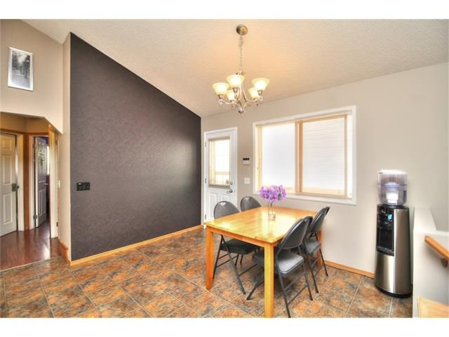 Photo 11: Photos: 89 BRIDLEWOOD Park SW in Calgary: Bridlewood House for sale : MLS®# C4033119