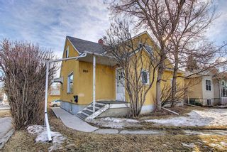 Photo 1: 801 20 Avenue NW in Calgary: Mount Pleasant Duplex for sale : MLS®# A1084565