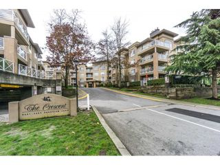 """Photo 1: 424 2551 PARKVIEW Lane in Port Coquitlam: Central Pt Coquitlam Condo for sale in """"THE CRESCENT"""" : MLS®# R2228836"""