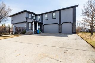 Main Photo: 202 Somerside Green SW in Calgary: Somerset Detached for sale : MLS®# A1098750