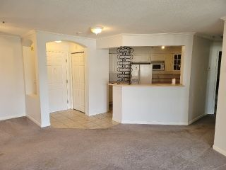 """Photo 2: 311 20125 55A Avenue in Langley: Langley City Condo for sale in """"BLACKBERRY LANE"""" : MLS®# R2552704"""