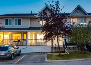 Photo 1: 218 950 ARBOUR LAKE Road NW in Calgary: Arbour Lake Row/Townhouse for sale : MLS®# A1136377